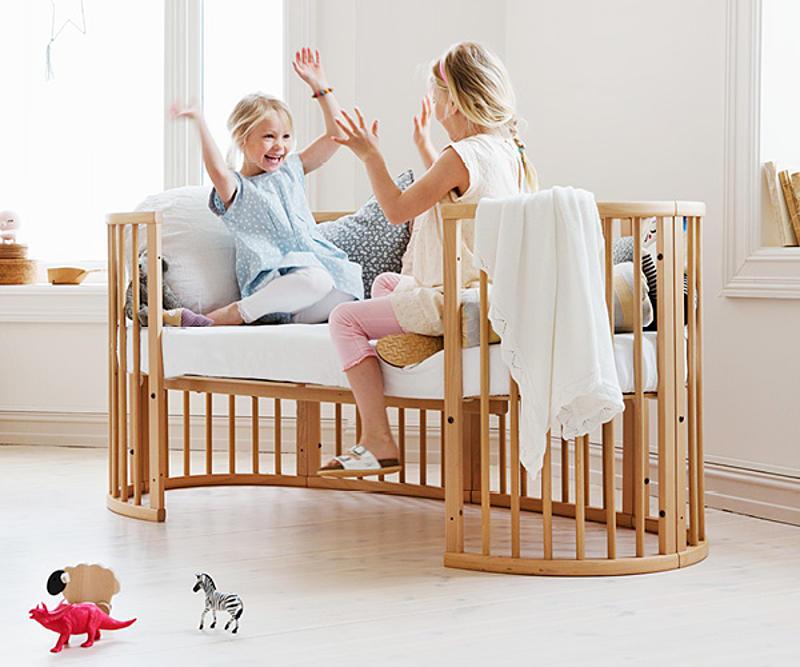 Children having fun in the Stokke Sleepi bed Juniors