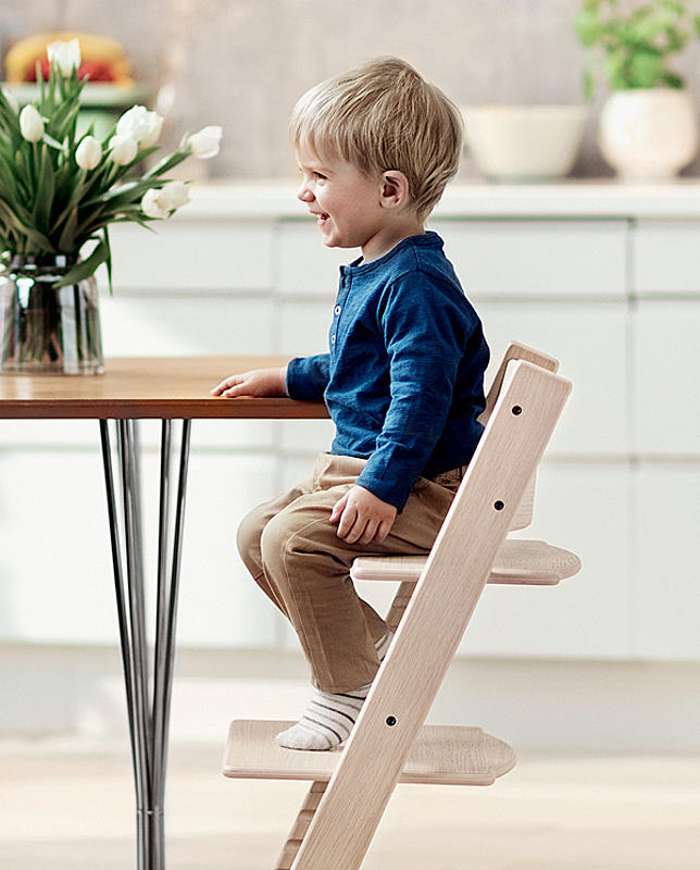 3-year old boy sitting in Tripp Trapp® chair