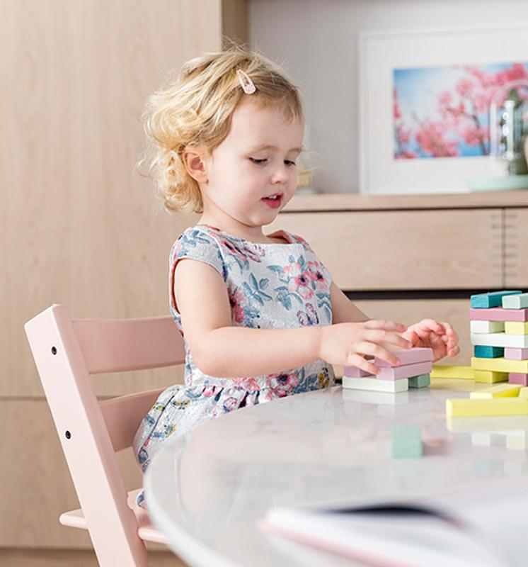 Baby girl playing with bricks