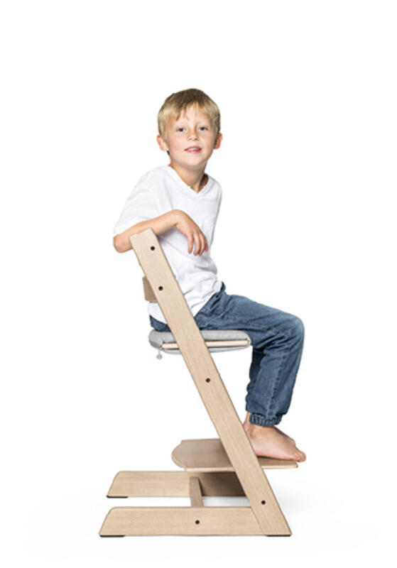 Kid sitting on tripp trapp chair