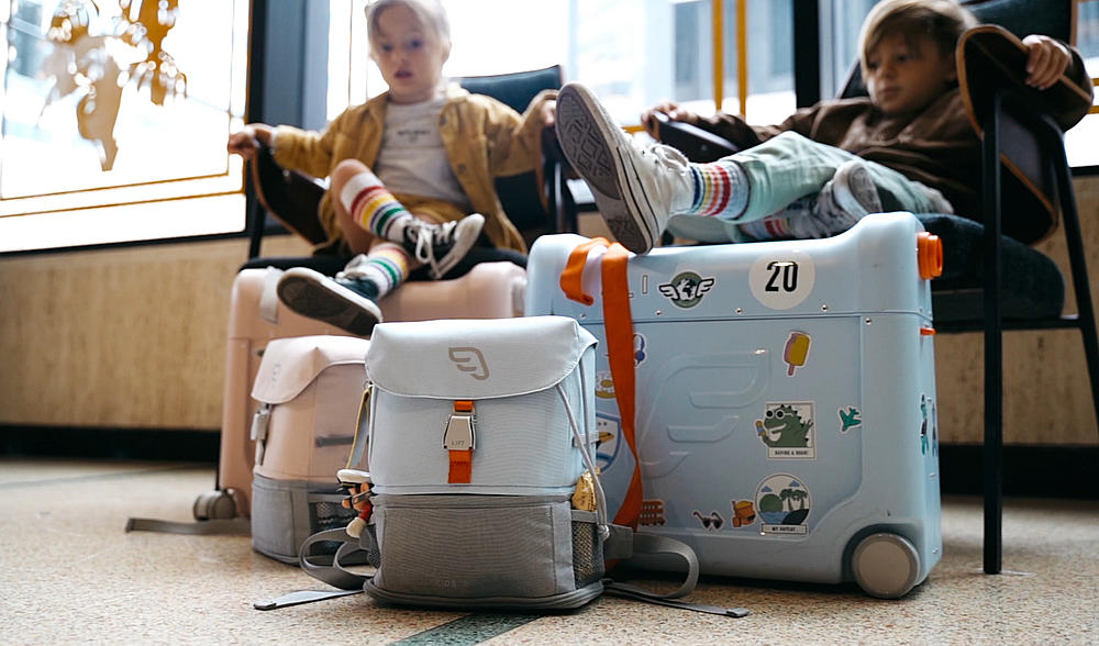 Kids sitting with Jetkids Bundle of Backpack and Bedbox