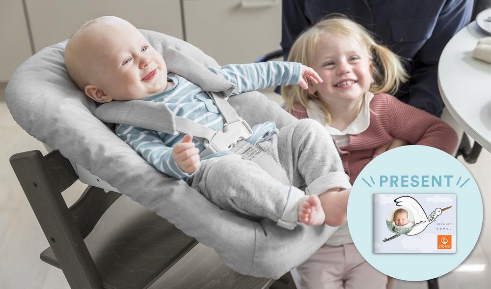 Kids laughing with newborn set