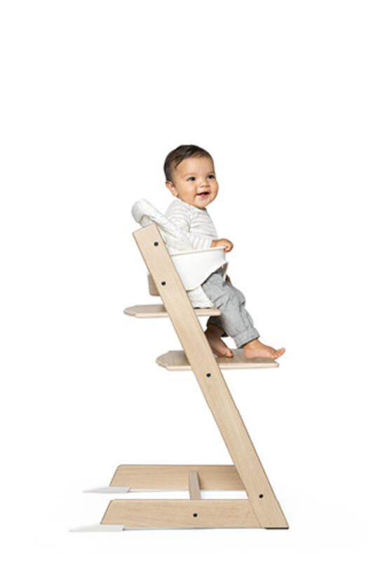 Child in Tripp Trapp Chair with baby set