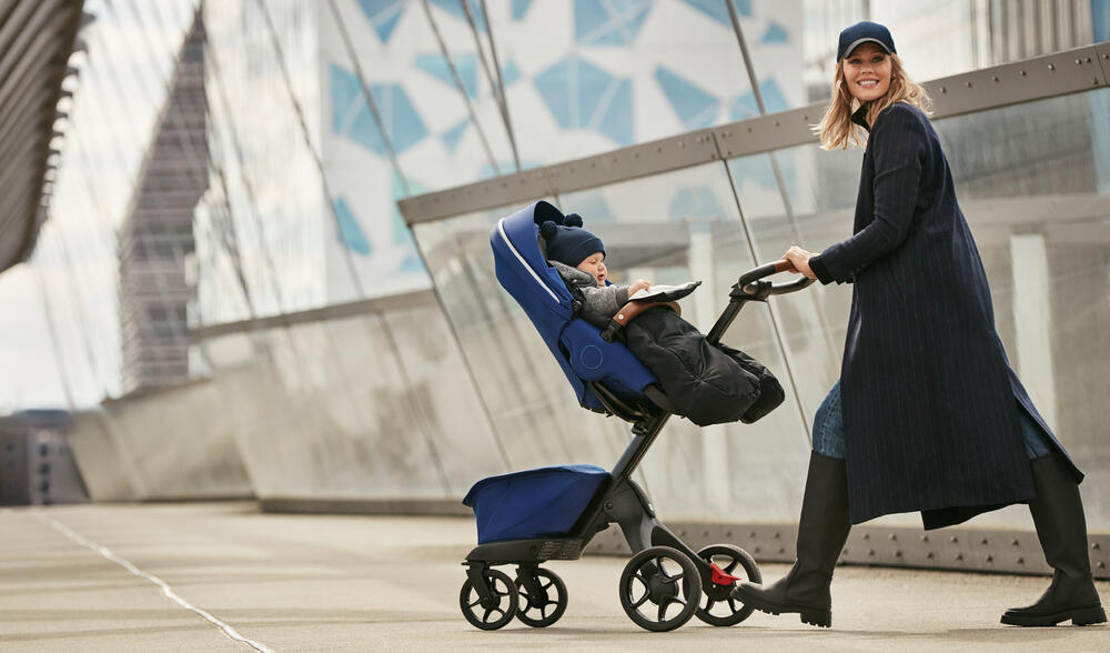 lady walking with xplory x stroller