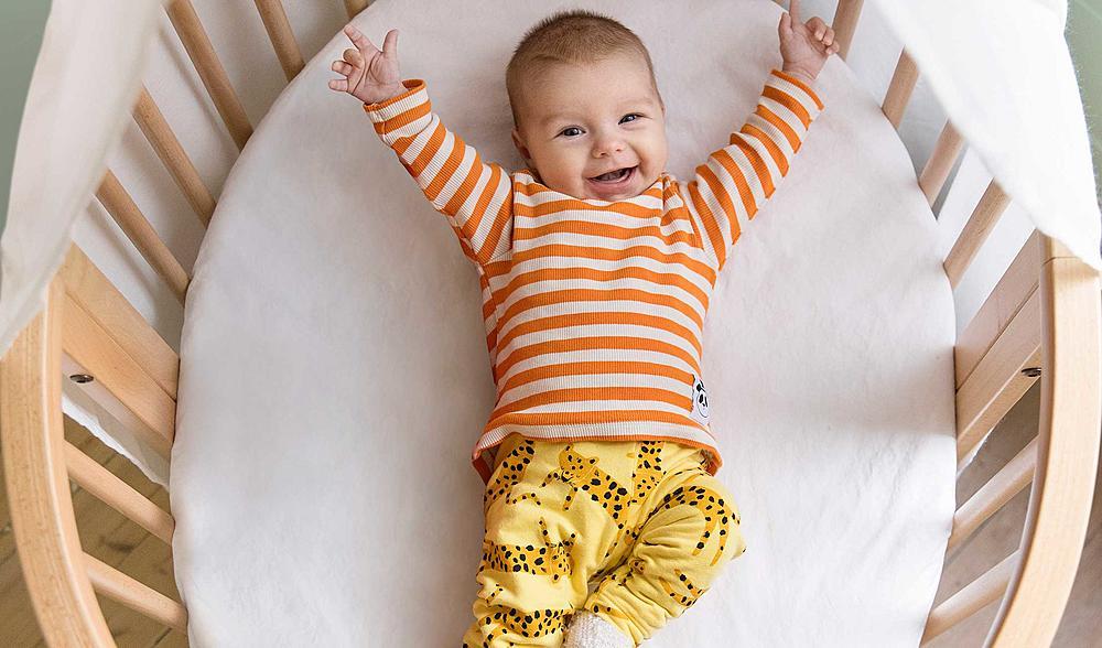 baby_smiling_in_Sleepi