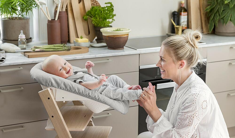 Mother playing with baby in Stokke Newborn Bundle Set