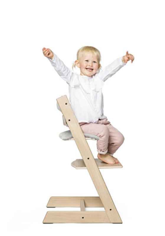 child on tripp trapp chair with cushion