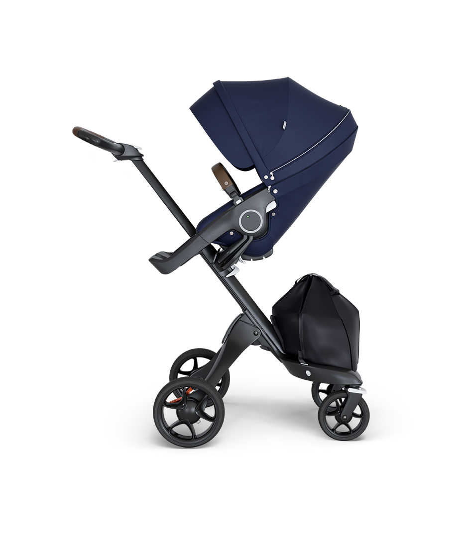 Stokke® Xplory® wtih Black Chassis and Leatherette Brown handle. Stokke® Stroller Seat Deep Blue.