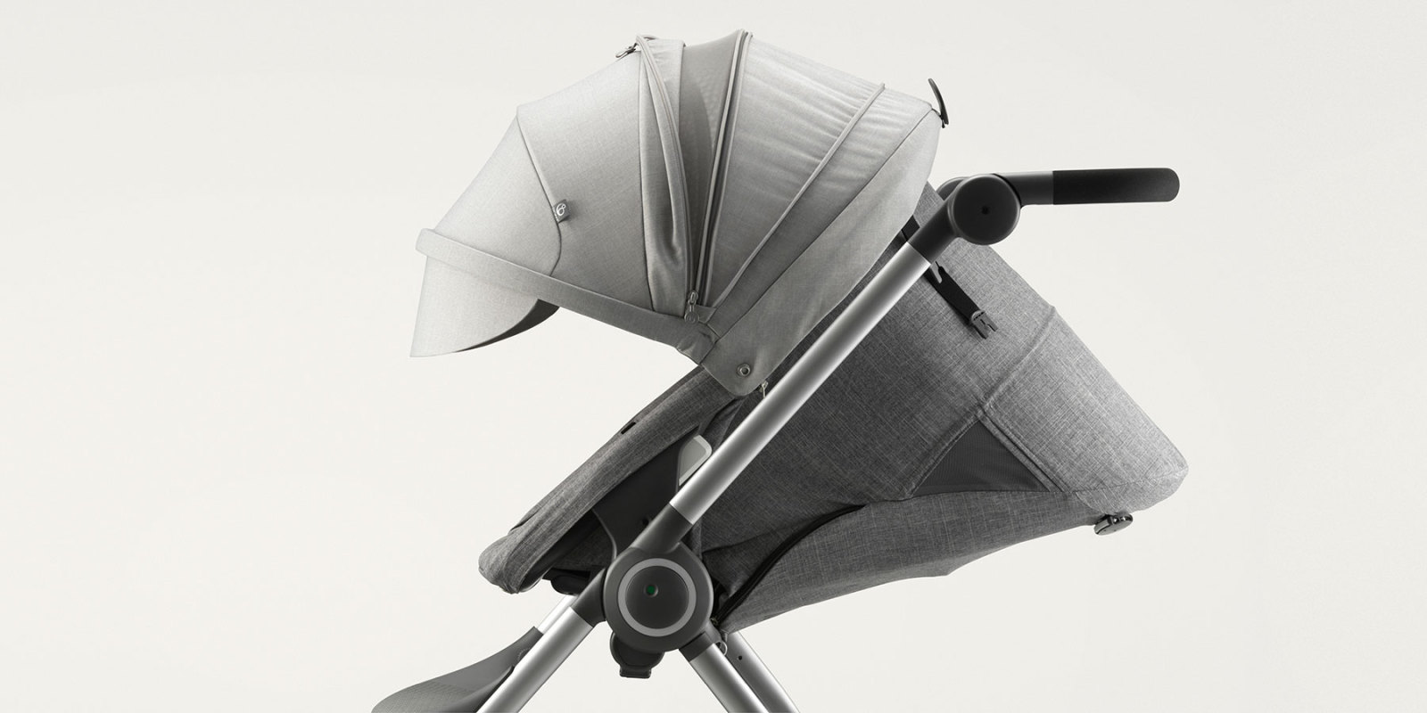 Stokke® Scoot™. Black Melange Seat with Grey Melange Canopy. Detail. Mainview.