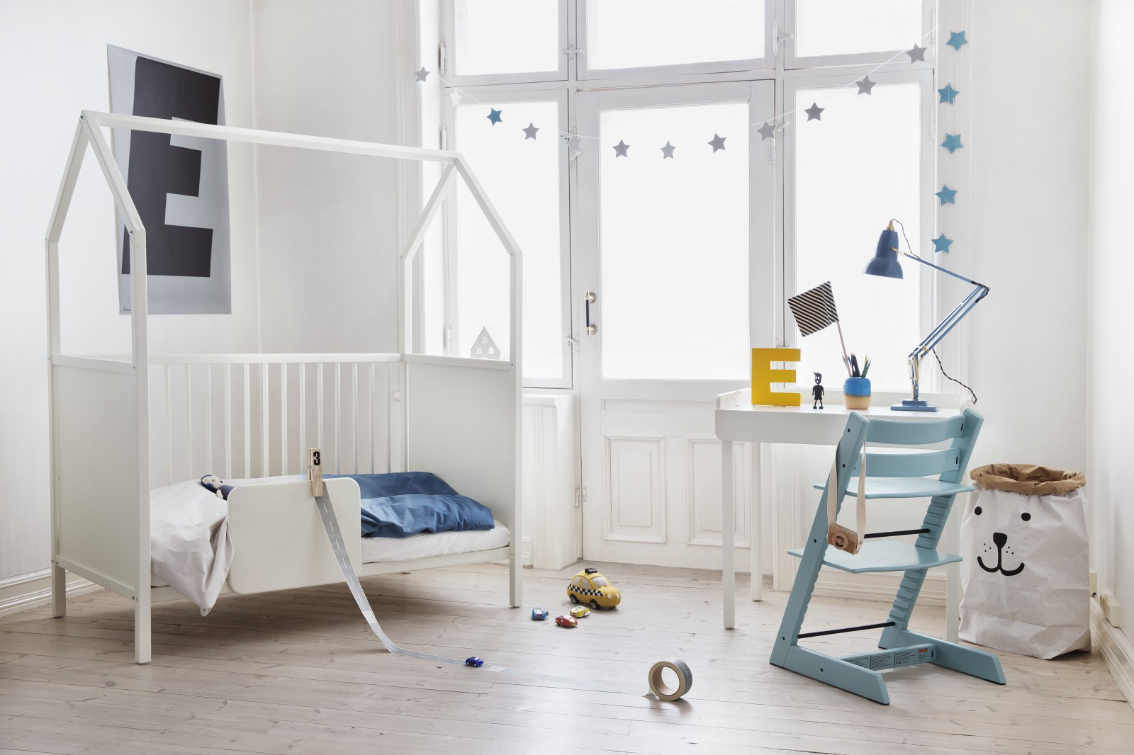 Stokke® Home™ Bed with Bed Guard and Stokke® Home™ Changer as desk.