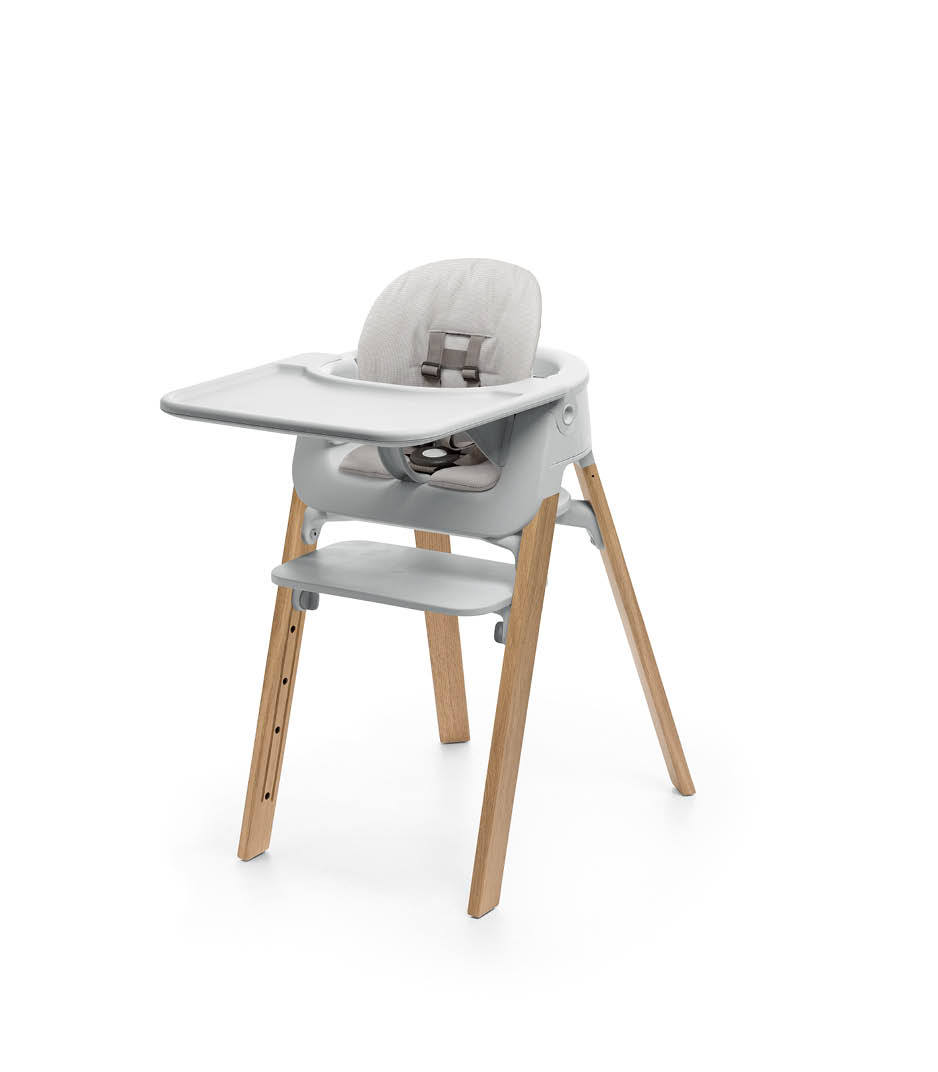 Stokke® Steps™ Oak Natural with Accessories. Baby Set Light Grey. Baby Set Cushion Timeless Grey. Baby Set Tray Light Grey.