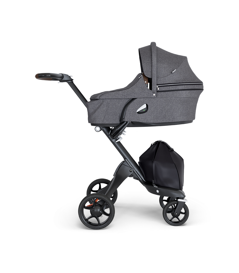 Stokke® Xplory® wtih Black Chassis and Leatherette Brown handle. Stokke® Stroller Carry Cot Black Melange.