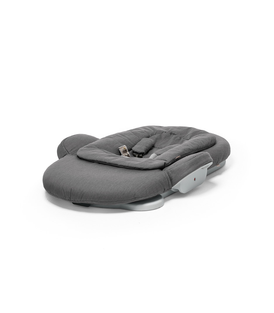 Stokke® Steps Bouncer in Deep Grey. Folded.