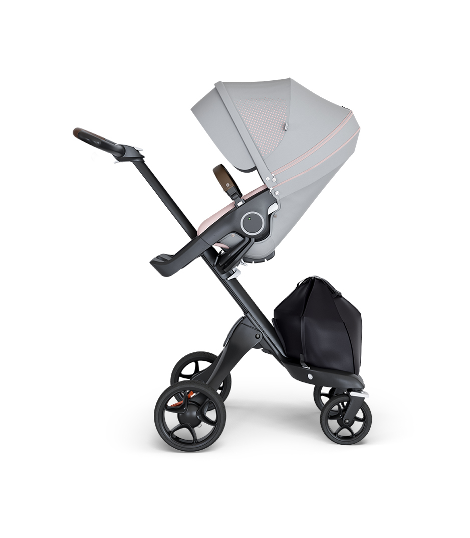 Stokke® Xplory® wtih Black Chassis and Leatherette Brown handle. Stokke® Stroller Seat Athleisure Pink.