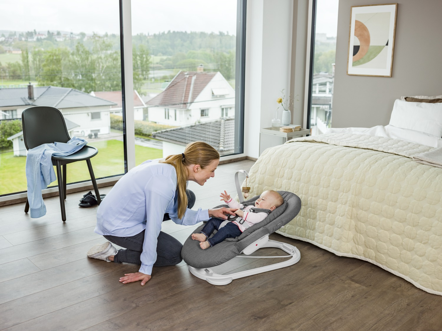 Stokke® Steps™ Bouncer in Deep Grey. On the floor.
