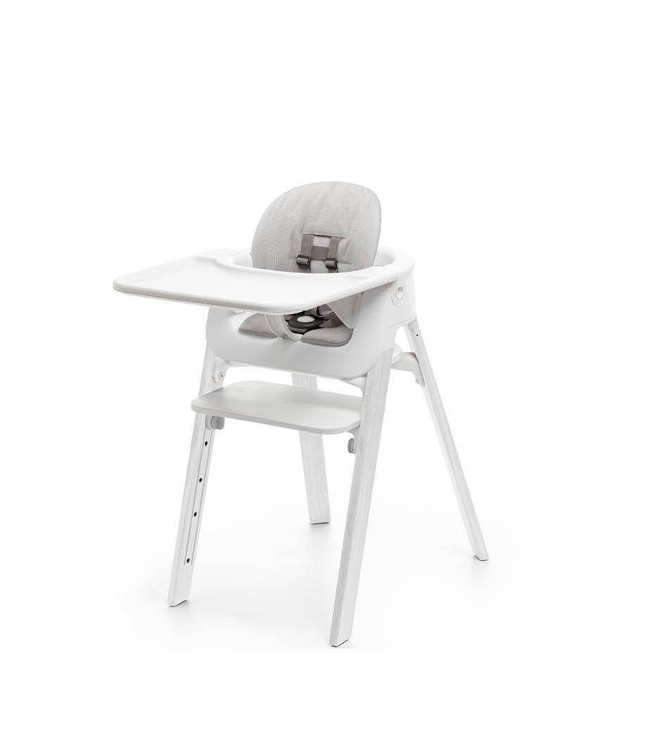 Stokke® Steps™ Oak White with Accessories. Baby Set White. Baby Set Cushion Timeless Grey. Baby Set Tray White.