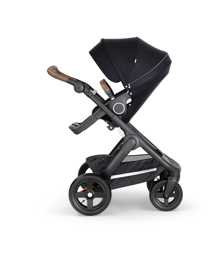 Stokke® Trailz™ with Black Chassis, Brown Leatherette and Terrain Wheels. Stokke® Stroller Seat, Black.