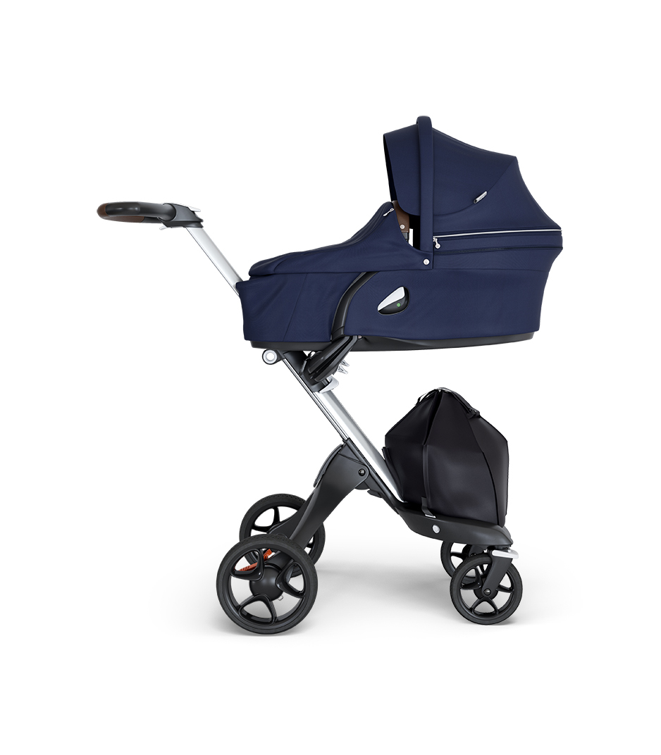 Stokke® Xplory® wtih Silver Chassis and Leatherette Brown handle. Stokke® Stroller Carry Cot Deep Blue.