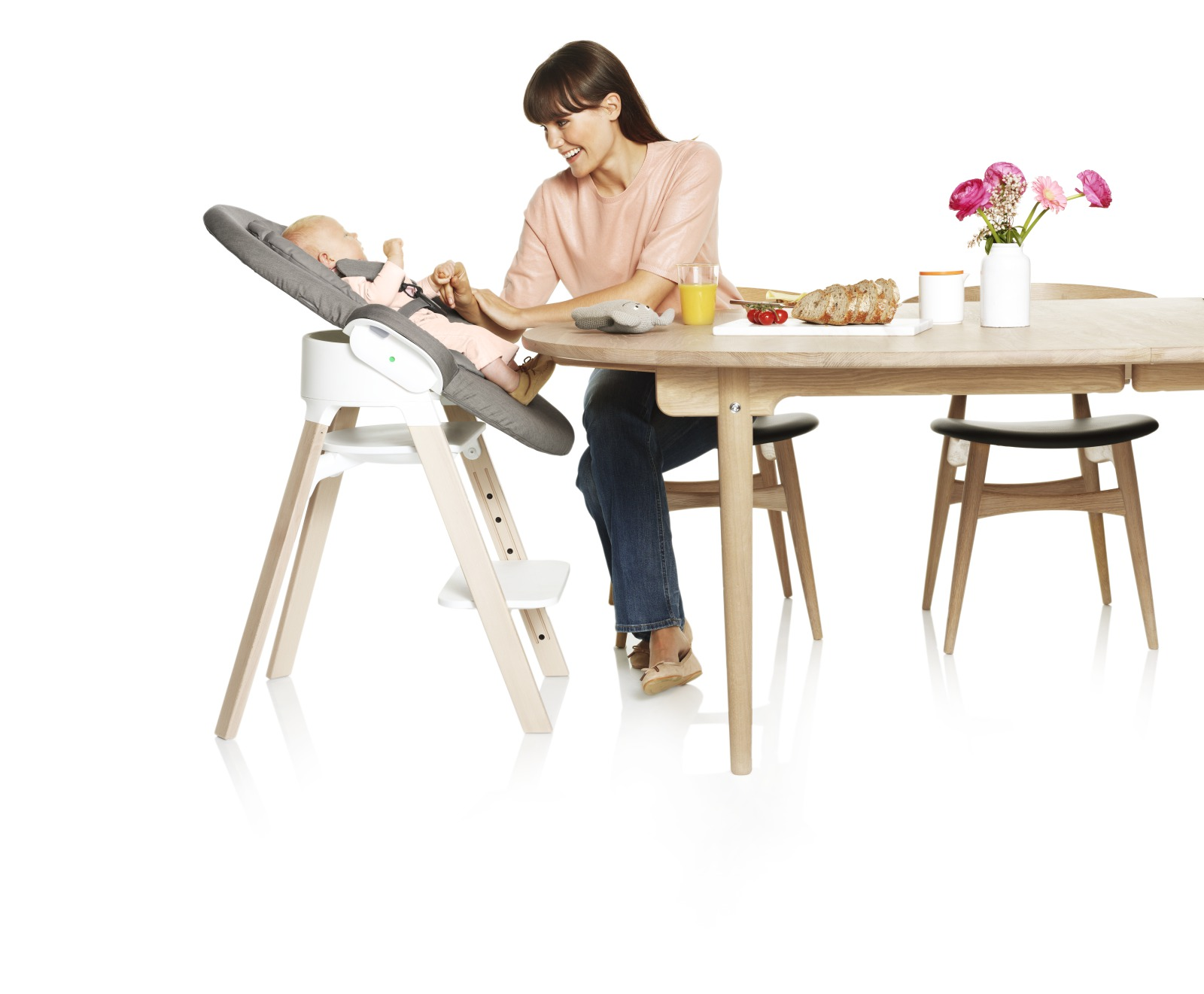 Stokke® Steps™ chair, Beech Natural, with Stokke® Steps™ Newborn Set attached. Greige Textiles.