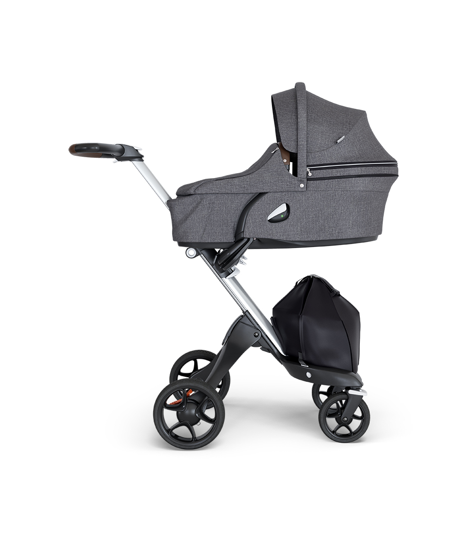 Stokke® Xplory® wtih Silver Chassis and Leatherette Brown handle. Stokke® Stroller Carry Cot Black Melange.