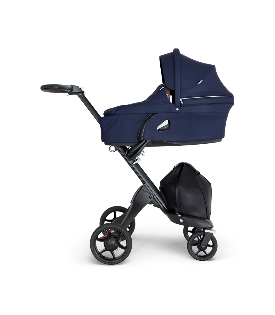 Stokke® Xplory® wtih Black Chassis and Leatherette Brown handle. Stokke® Stroller Carry Cot Deep Blue.
