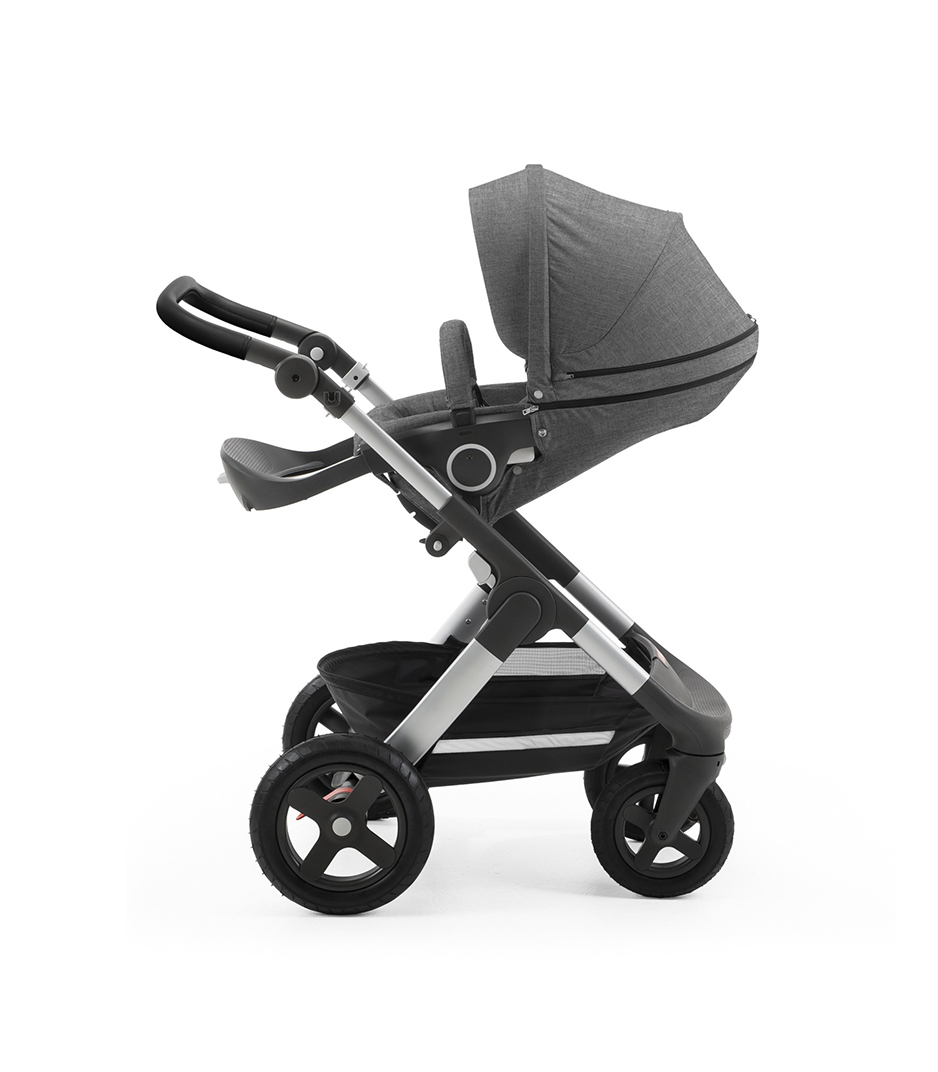 Stokke® Trailz with silver chassis and Stokke® Stroller Seat, parent facing, sleep position. Black Melange. Terrain wheels. Leatherette Handle.