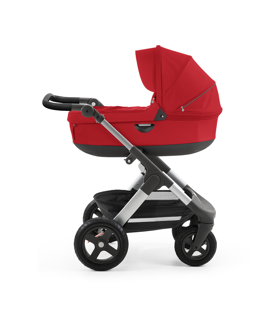 Stokke® Trailz™ with silver chassis  and Stokke® Stroller Carry Cot, Red. Leatherette Handle.