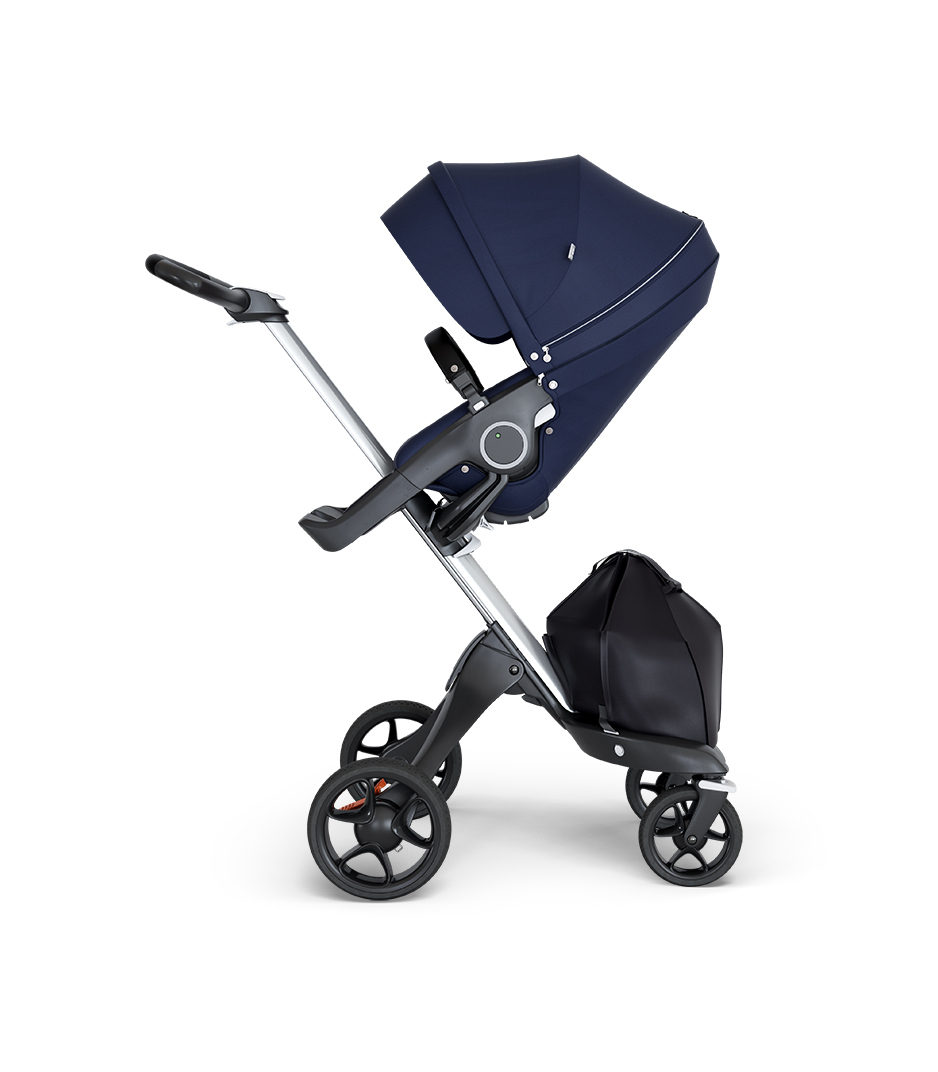 Stokke® Xplory® wtih Silver Chassis and Leatherette Black handle. Stokke® Stroller Seat Deep Blue.