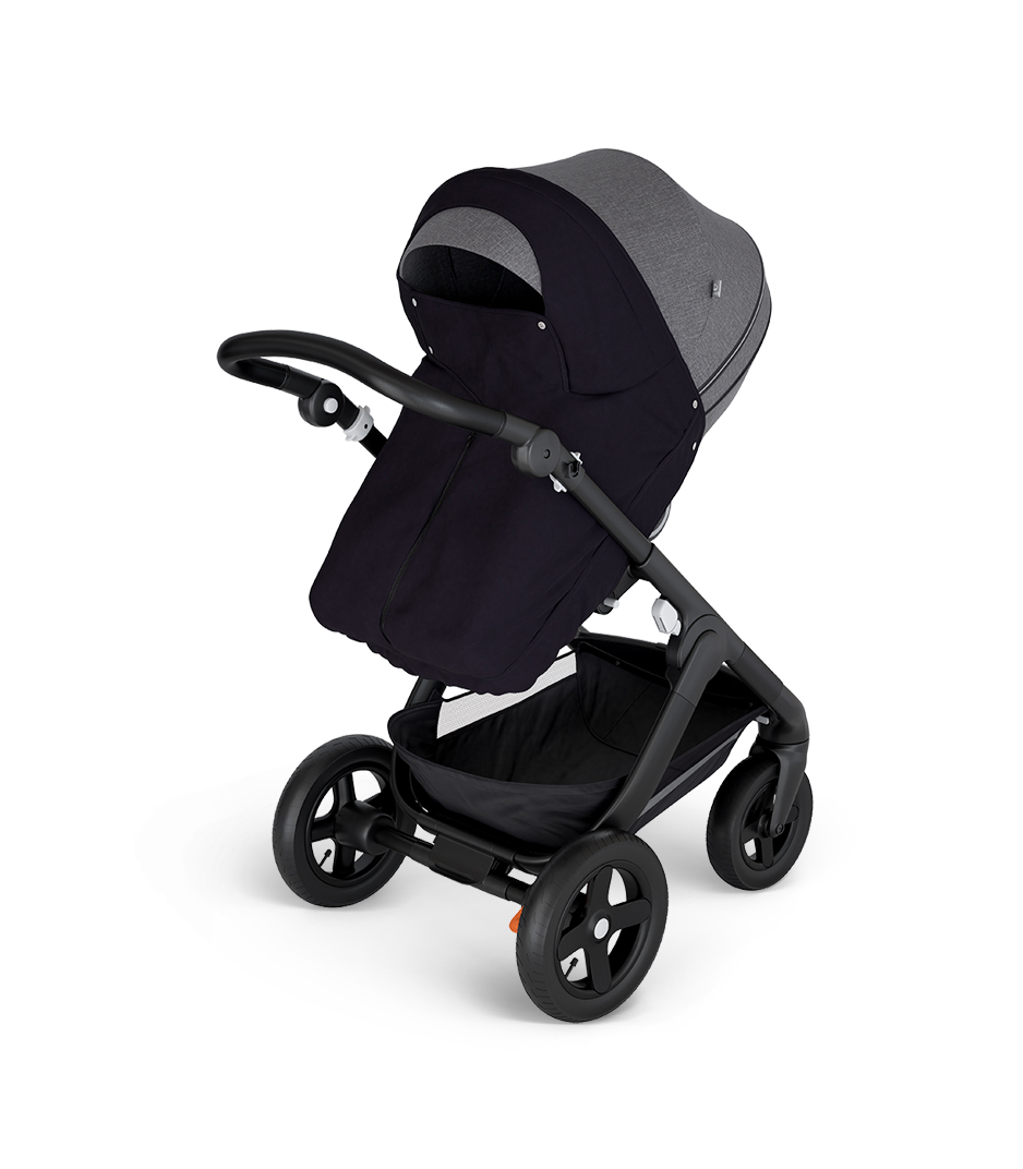Stokke® Trailz™ with Black Chassis and Stokke® Stroller Seat Black Melange. Stokke® Stroller Storm Cover, Black.