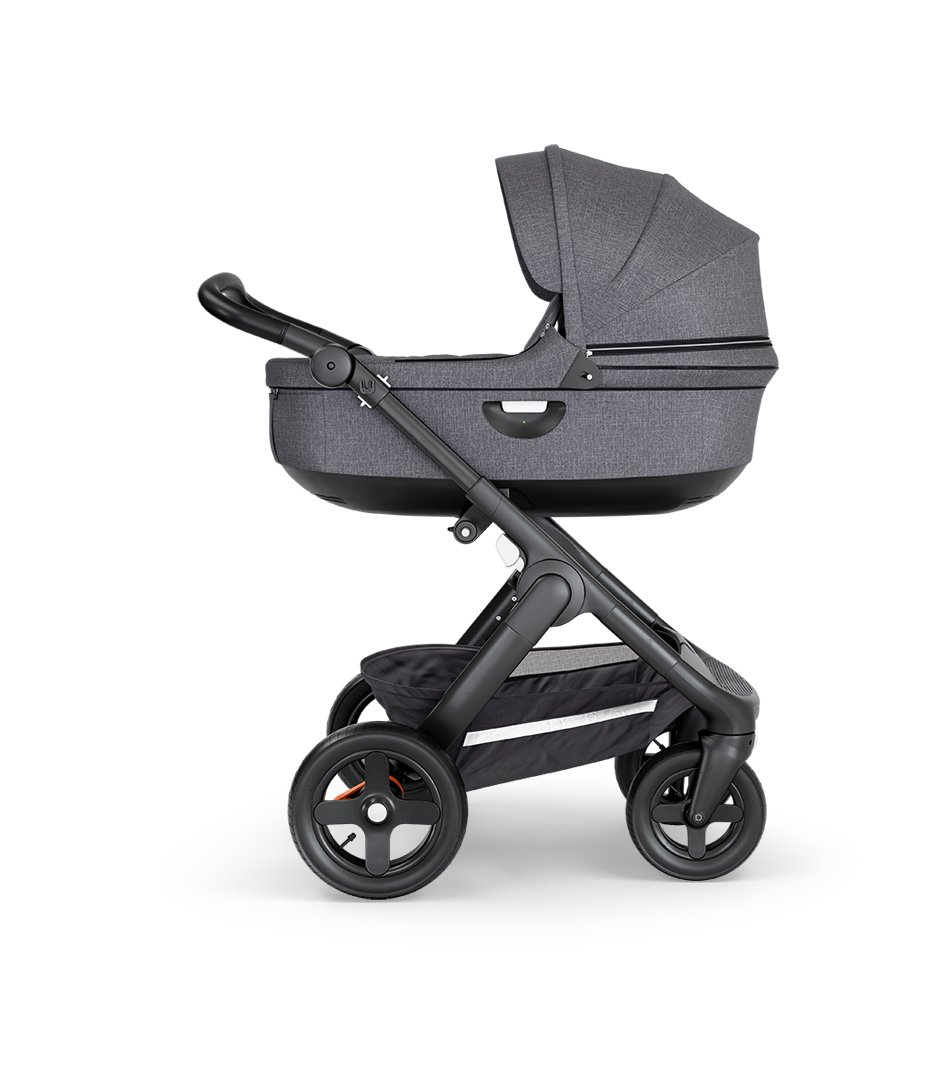 Stokke® Trailz™ with Black Chassis, Black Leatherette and Terrain Wheels. Stokke® Stroller Carry Cot, Black Melange.