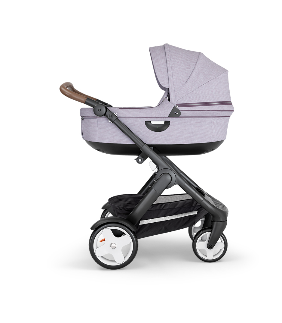 Stokke® Trailz™ with Black Chassis, Brown Leatherette and Classic Wheels. Stokke® Stroller Carry Cot, Brushed Lilac.