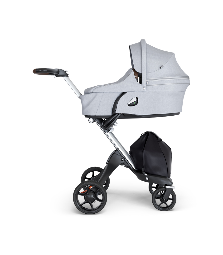 Stokke® Xplory® wtih Silver Chassis and Leatherette Brown handle. Stokke® Stroller Carry Cot Grey Melange.