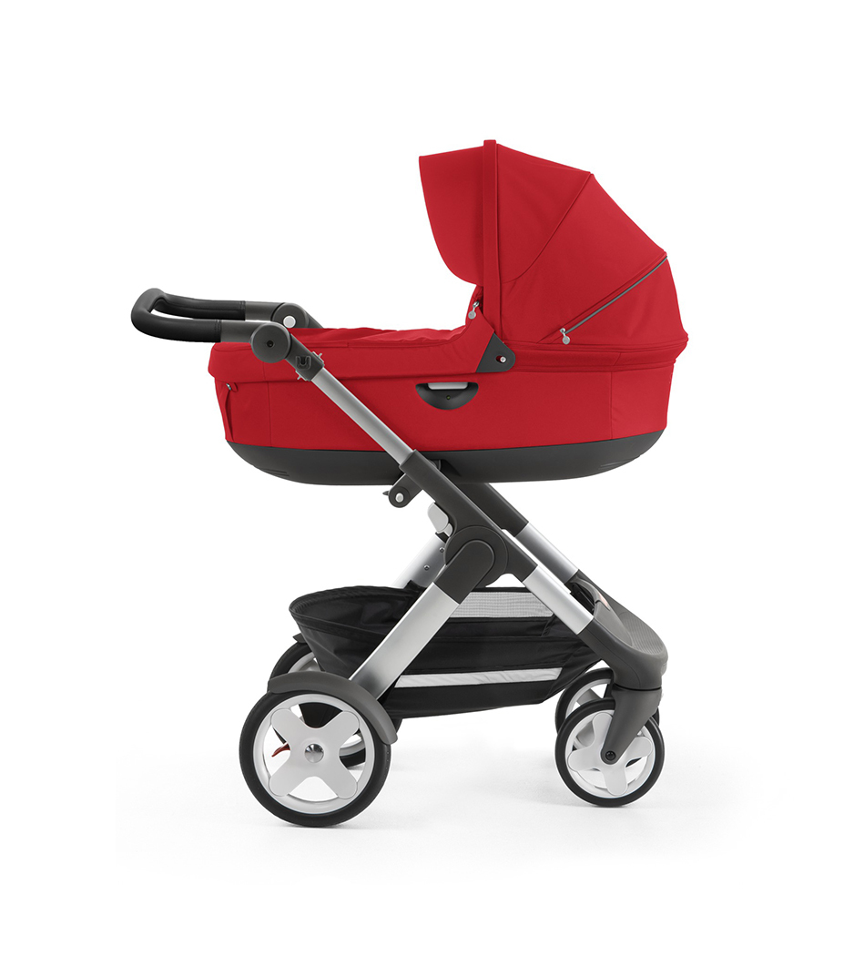Stokke® Trailz™ with silver chassis and Stokke® Stroller Carry Cot, Red. Classic Wheels.