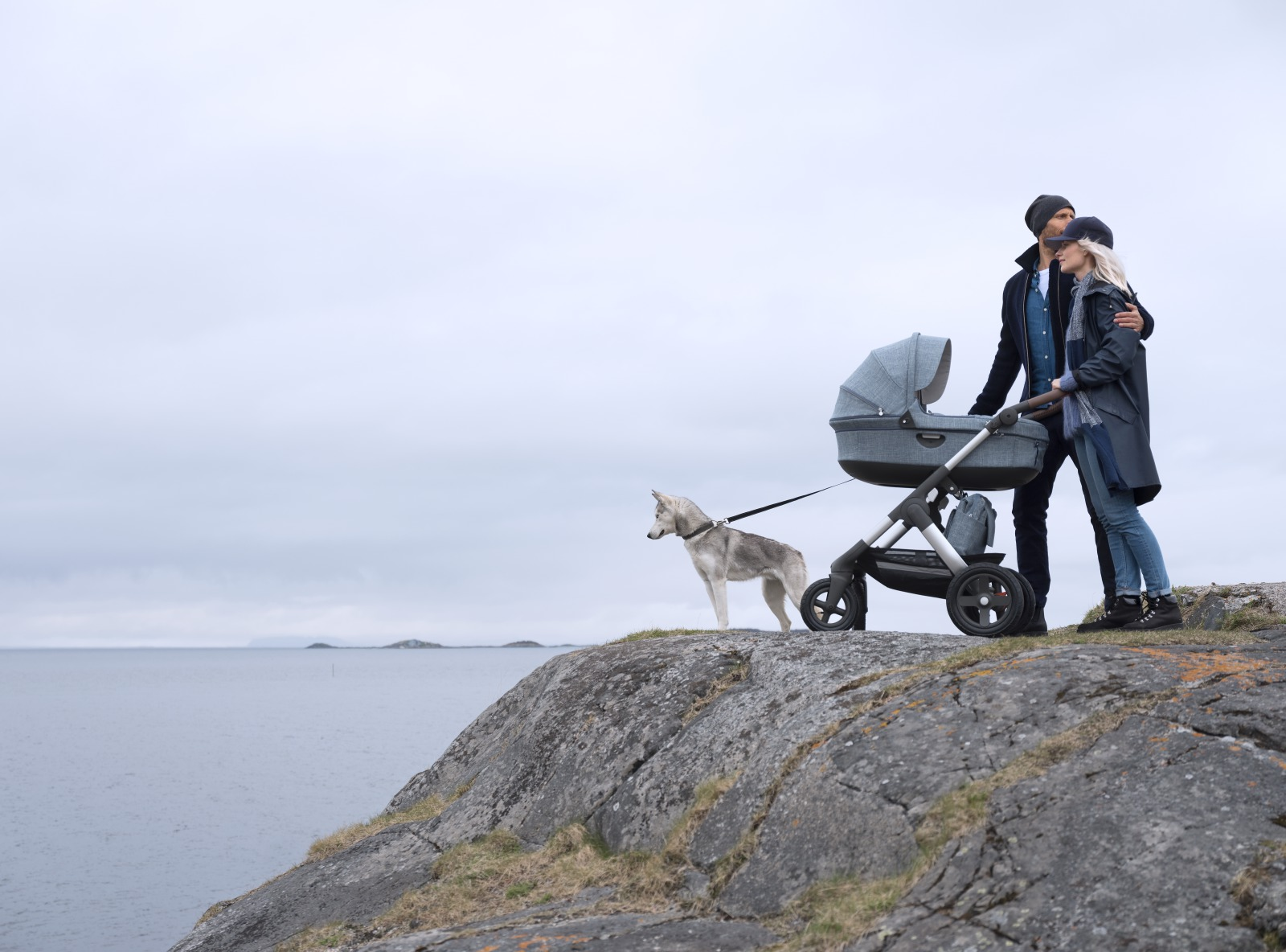 Stokke® Trailz™ with silver chassis and Stokke™ Stroller Carry Cot, Nordic Blue.