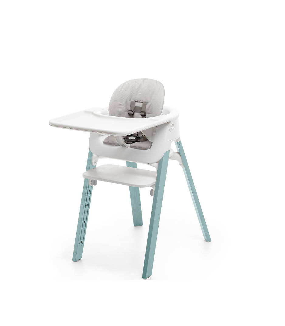 Stokke® Steps™ Aqua Blue with Accessories. Baby Set White. Baby Set Cushion Timeless Grey. Baby Set Tray White.