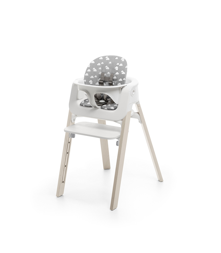 Stokke® Steps™ Whitewash with Baby Set and Grey Clouds Cushion.
