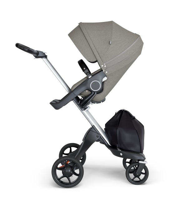 Stokke® Xplory® wtih Silver Chassis and Leatherette Black handle. Stokke® Stroller Seat Seat Brushed Grey.