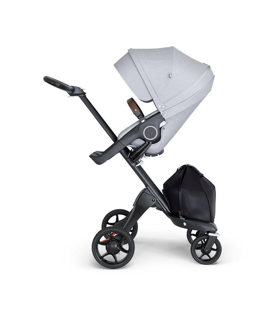 Stokke® Xplory® wtih Black Chassis and Leatherette Brown handle. Stokke® Stroller Seat Grey Melange.