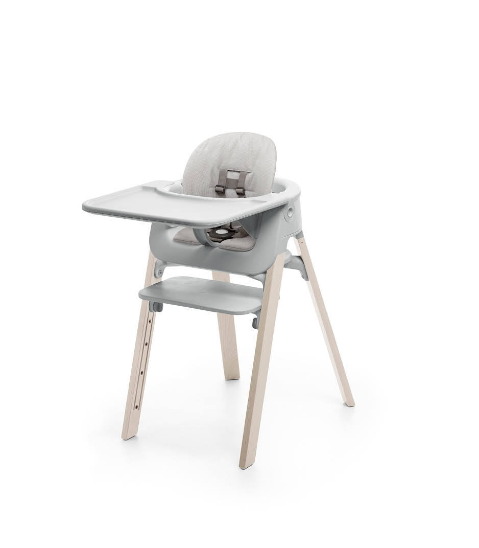 Stokke® Steps™ Whitewash with Accessories. Baby Set Light Grey. Baby Set Cushion Timeless Grey. Baby Set Tray Light Grey.