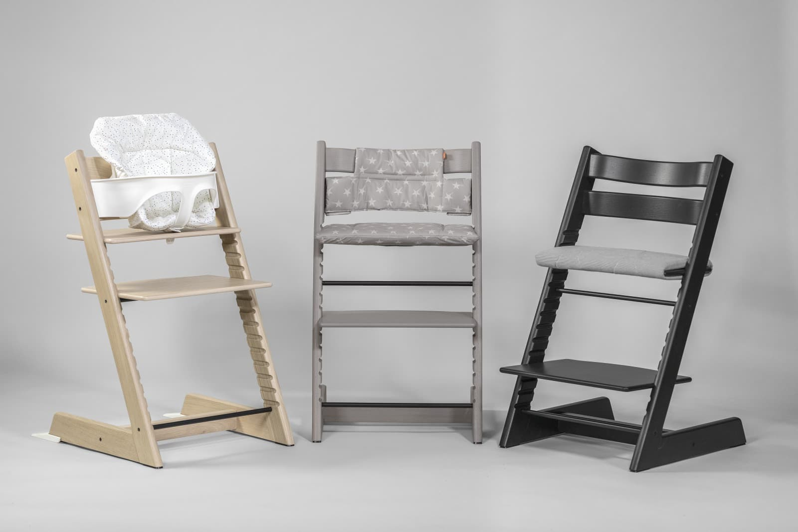 Tripp Trapp® chair, Oak Black, Greywash and White, with White Baby Set and Soft Sprinkle Cushion.