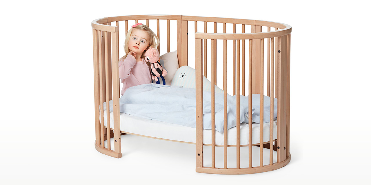 Stokke® Sleepi™ Bed in setting. Open bed.