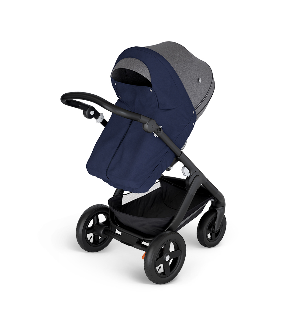 Stokke® Trailz™ with Black Chassis and Stokke® Stroller Seat Black Melange. Stokke® Stroller Storm Cover, Deep Blue.