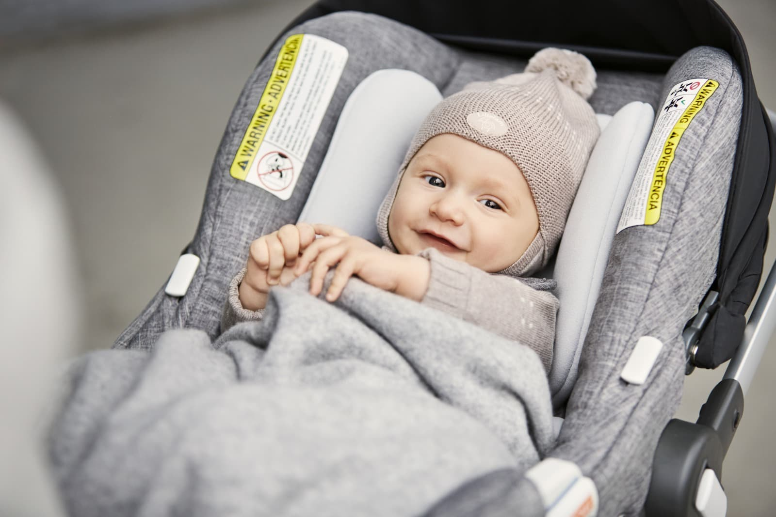 Stokke® PIPA by Nuna® Car Seat, Black Melange. Mounted on Stokke® Xplory®.