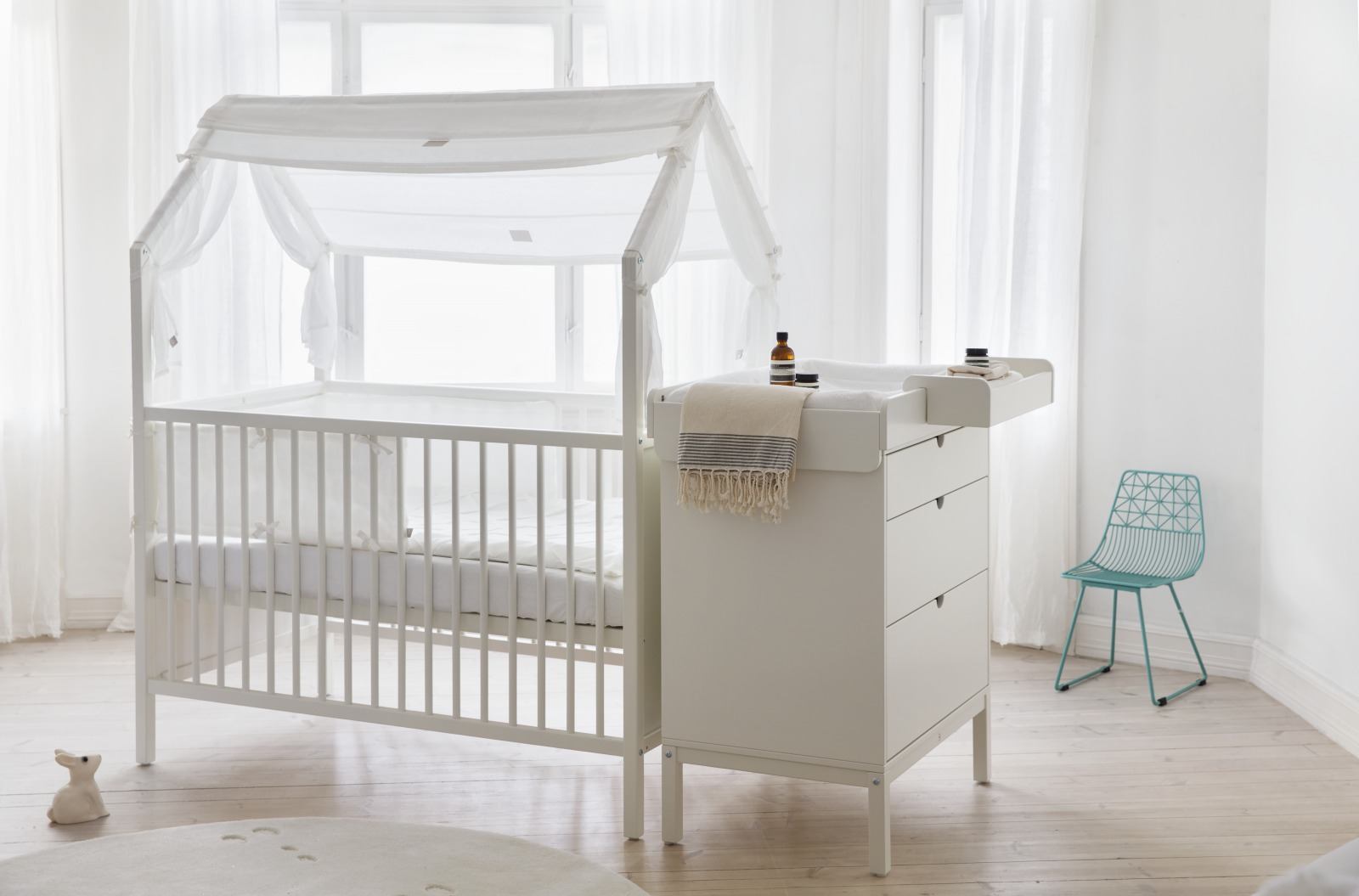 Stokke® Home™ Bed with Roof textiles, Stokke® Half Bumper and Stokke® Home™ Dresser with Changer on top.
