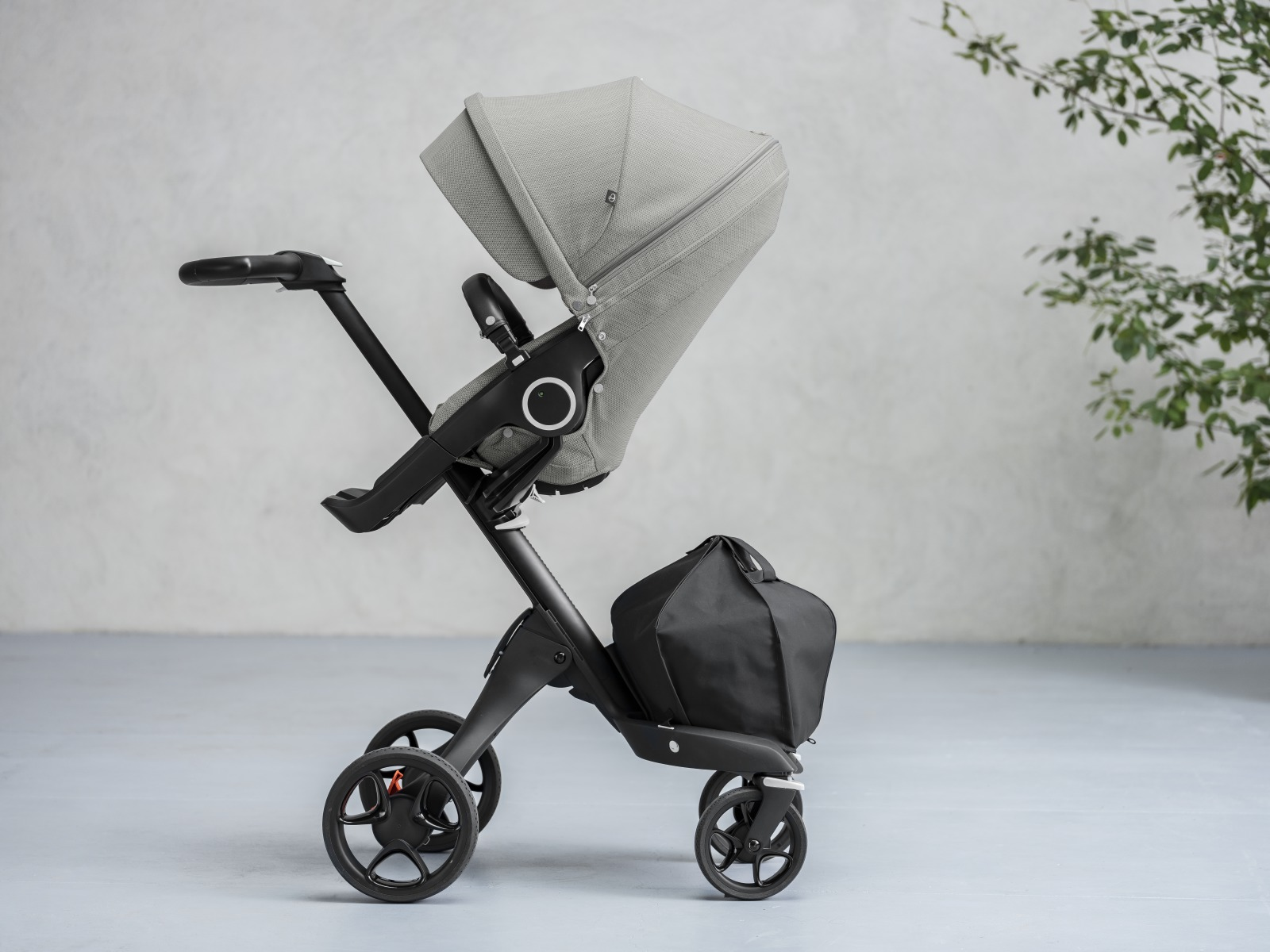 Stokke® Xplory® with Black Chassis and Stokke® Stroller Seat, Brushed Grey.