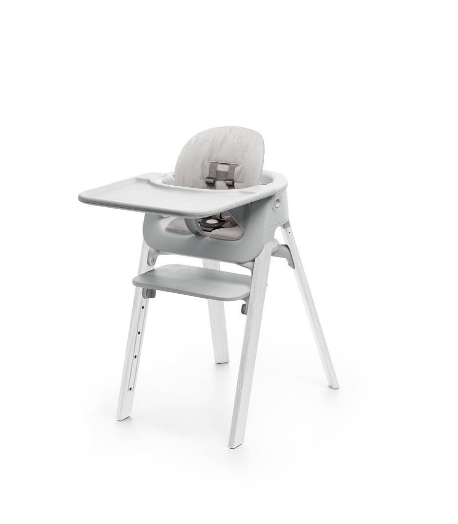 Stokke® Steps™ Oak White with Accessories. Baby Set Light Grey. Baby Set Cushion Timeless Grey. Baby Set Tray Light Grey.