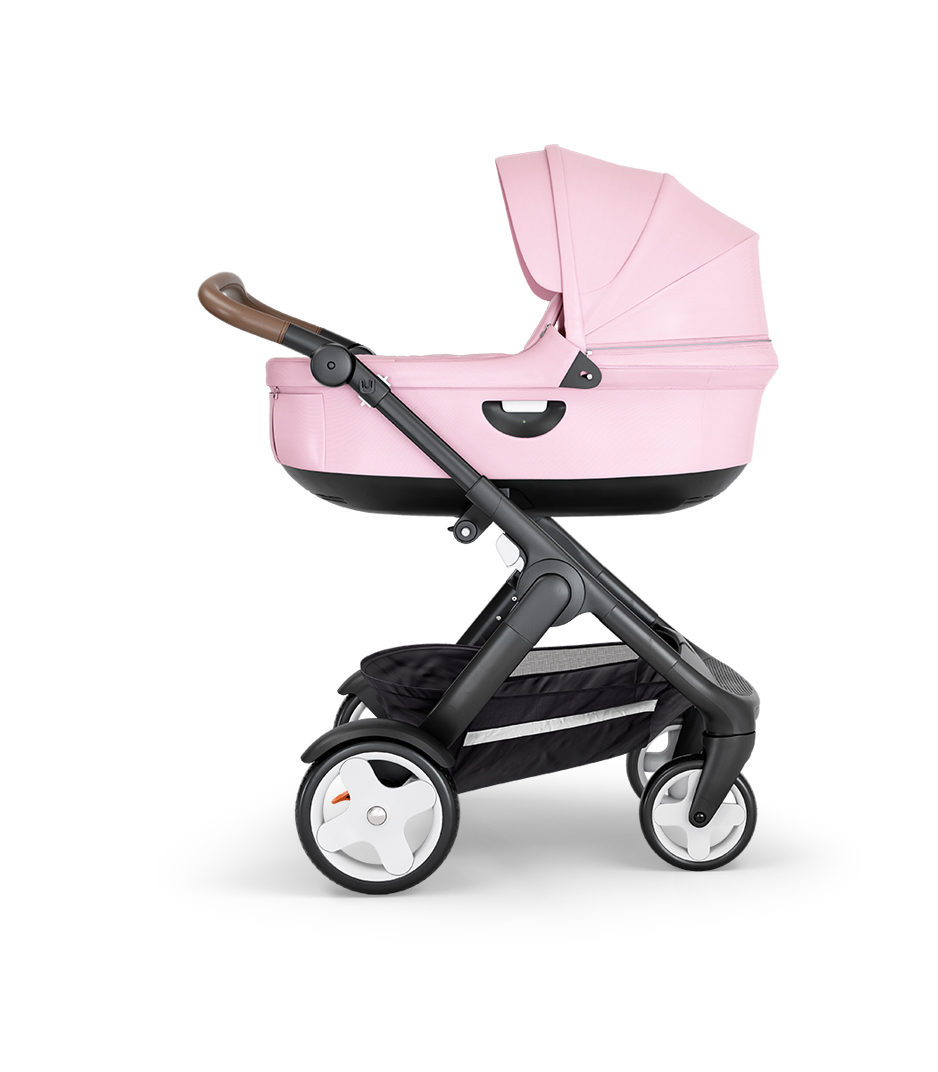 Stokke® Trailz™ with Black Chassis, Brown Leatherette and Classic Wheels. Stokke® Stroller Carry Cot, Lotus Pink.