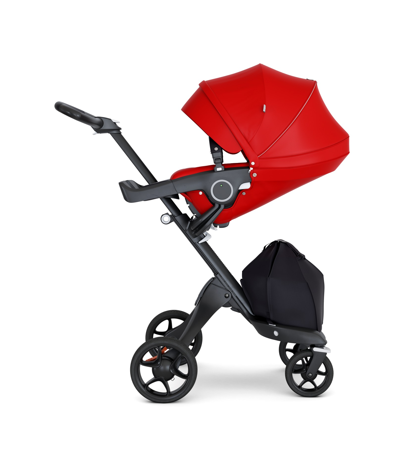 Stokke® Xplory® with Black Chassis and Leatherette Black handle. Stokke® Stroller Seat Red with extended canopy.