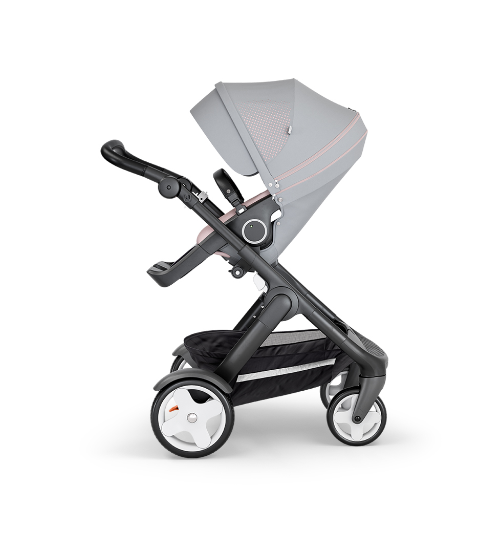 Stokke® Trailz™ with Black Chassis, Black Leatherette and Classic Wheels. Stokke® Stroller Seat, Athleisure Pink.
