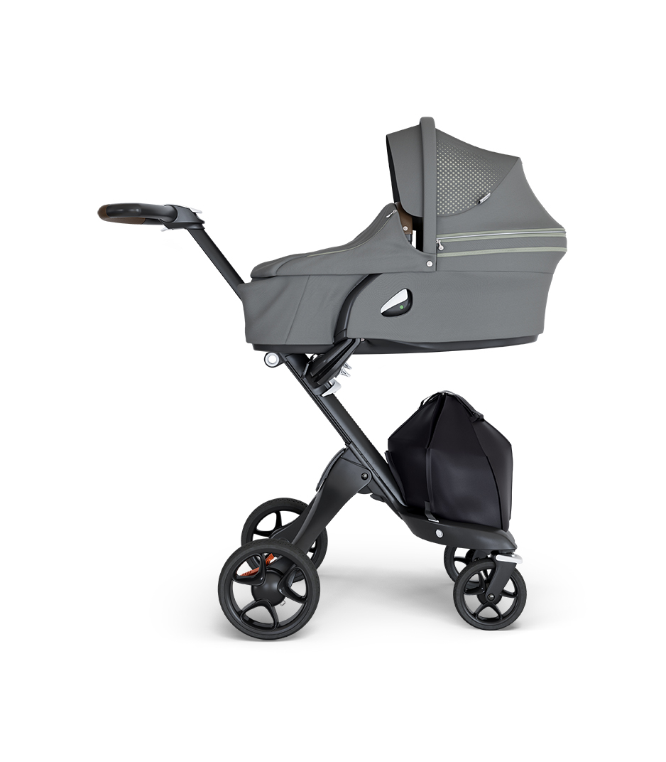 Stokke® Xplory® wtih Black Chassis and Leatherette Brown handle. Stokke® Stroller Carry Cot Athleisure Green.